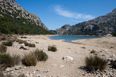 Depleted Reservoir. Blue Gorge (Gorg Blau) Reservoir in Mallorca, Spain, showing depleted levels of water royalty free stock image