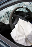 Deployed airbag in crashed car. Royalty Free Stock Photos