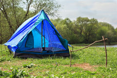 Deployed tent stands on river bank Stock Photography