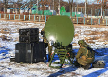 Deploying army radio station in field conditions. Actions of soldiers communicators to bring to the working position portable kit of the military field radio stock image