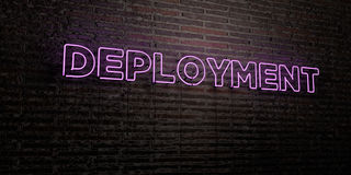 DEPLOYMENT -Realistic Neon Sign on Brick Wall background - 3D rendered royalty free stock image. Can be used for online banner ads and direct mailers Royalty Free Stock Images