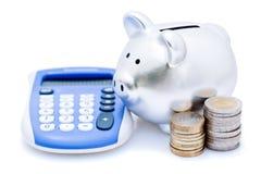 deponować pieniądze kalkulatora prosiątko Fotografia Royalty Free