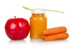 Deponuje pieniądze jabłka, marchewki, dziecka puree odizolowywający na bielu Zdjęcia Royalty Free