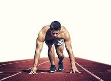 Deporte Corredor joven en la línea del comienzo Aislado en blanco Fotos de archivo