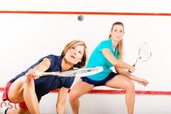 Deporte de la raqueta de calabaza en gimnasia, competición de las mujeres Imágenes de archivo libres de regalías