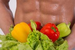 Deporte y dieta Hombre atractivo con el cuerpo muscular foto de archivo