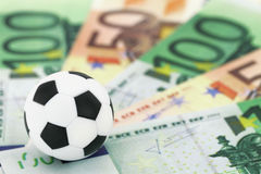 Deportes y dinero Foto de archivo