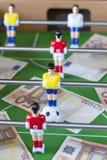 Deportes y dinero fotos de archivo
