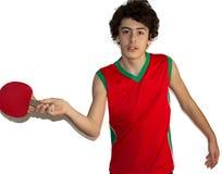 Deportista adolescente que juega a tenis de mesa Foto de archivo libre de regalías