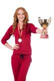 Deportista bastante de sexo femenino con el premio aislado encendido Imagen de archivo
