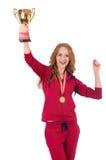 Deportista bastante de sexo femenino con el premio aislado encendido Imagen de archivo libre de regalías