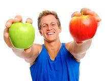 Deportista feliz con dos manzanas Foto de archivo libre de regalías