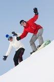 Deportista feliz con los snowboards Foto de archivo libre de regalías
