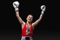 Deportista joven del boxeador en traje rojo del deporte Imagen de archivo