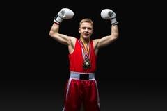 Deportista joven del boxeador en traje rojo del deporte Fotografía de archivo