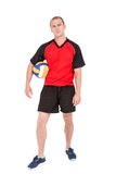 Deportista que lleva a cabo un voleibol Imagenes de archivo