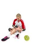 Deportista que lleva una rodillera Imagen de archivo