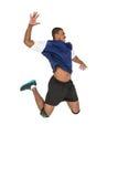 Deportista que presenta mientras que juega a voleibol Fotos de archivo