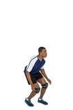 Deportista que presenta mientras que juega a voleibol Imagen de archivo