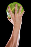Deportista que sostiene una bola Fotografía de archivo libre de regalías
