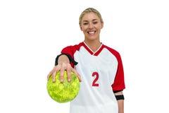 Deportista que sostiene una bola Foto de archivo
