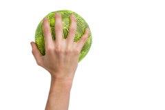 Deportista que sostiene una bola Imagen de archivo