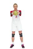 Deportista que sostiene una bola Imagen de archivo libre de regalías