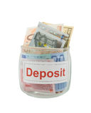 Deposit. Conceptual photo of a deposit. Euro and dollar banknotes in a glass jar isolated over white stock images
