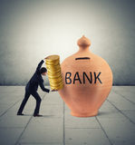 Deposit gains in a bank Stock Image