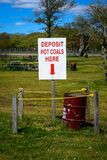 Deposit hot coals here sign. A deposit hot coals here sign at a park Royalty Free Stock Photos