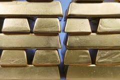 Deposit of illegal gold in amount of 500 kilos in standard bricks. Hundreds kilos of illegal gold bullions on background stock photography