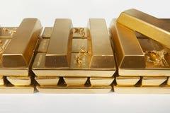 Deposit of illegal gold in amount of 500 kilos in standard bricks. Hundreds kilos of illegal gold bullions on background royalty free stock image