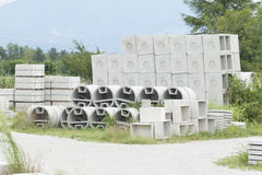 Deposit of prefabricated concrete. For wells and water discharges Stock Photo
