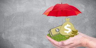 Deposit protection and protect currency. Deposit protection, protect investment or banking concept. money bag, banknote on hand with protected by umbrella Royalty Free Stock Photography