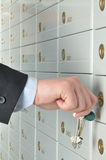 Deposit safe bank. Copula of the keys is in the hands of business man which opens the deposit safe in a bank Stock Image