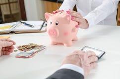 Deposit savings in the bank Stock Photo