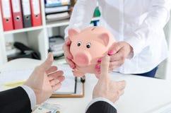 Deposit savings in the bank Stock Photos