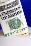 Deposit ten dollars into the piggy bank Stock Photography