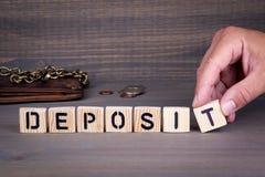 Deposit. Wooden letters on dark background Stock Image