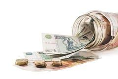 Deposite com dinheiro, dólares, euro e as moedas dispersadas Imagens de Stock
