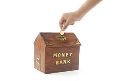 Depositing money in Money Box Stock Photography