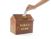 Depositing money in Money Box Royalty Free Stock Photo