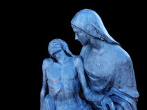 Deposition of the Christ. Bronze sculpture. Black background Stock Photo