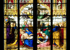 Deposition of Christ on stained glass Stock Photo