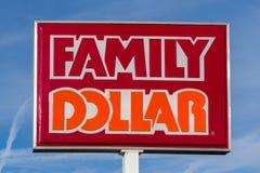 Deposito e segno del dollaro della famiglia Fotografie Stock