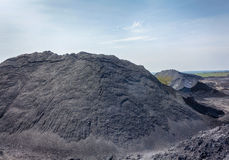 Deposits of coal in the territory of the coal preparation plant Stock Photo