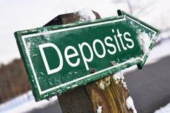Deposits road sign. Against winter landscape Stock Images