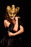 Depraved woman in golden half mask Stock Photography