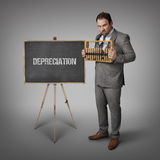 Depreciation text on blackboard with businessman Royalty Free Stock Image