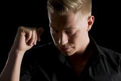Depresja kluczowy portret młody przystojny mężczyzna patrzeje w dół. Zdjęcie Royalty Free